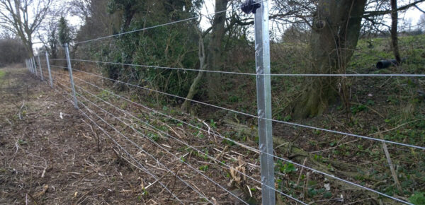Flood Fence – Field riverside at Carrant Brook in Gloucestershire.